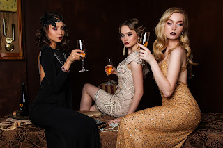 woman in glamour dress sipping champagne luxury surrounding