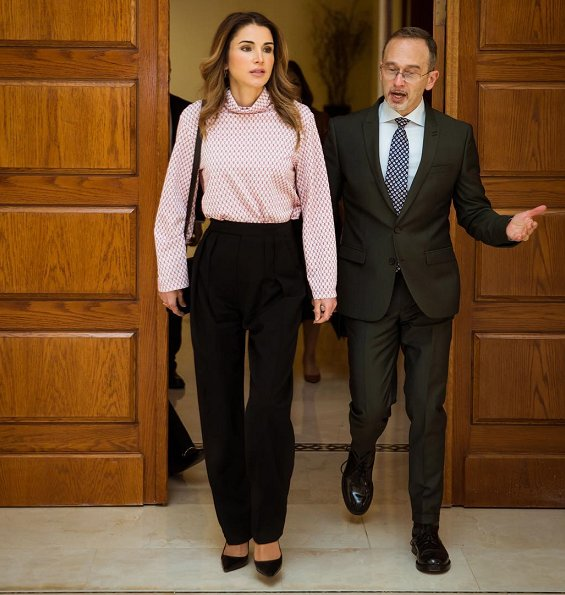 King Hussein Bin Talal Convention Center in Dead Sea in Jordan. Queen Rania wore Fendi pink dot blouse