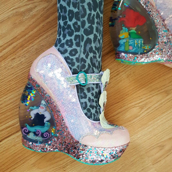 ursula figure inside glitterglobe heel of shoe