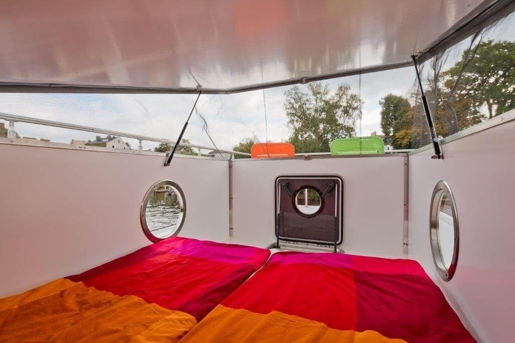 10-Top-Double-Bedroom-Nautino-Tiny-Houseboat-Architecture-on-the-Water-www-designstack-co