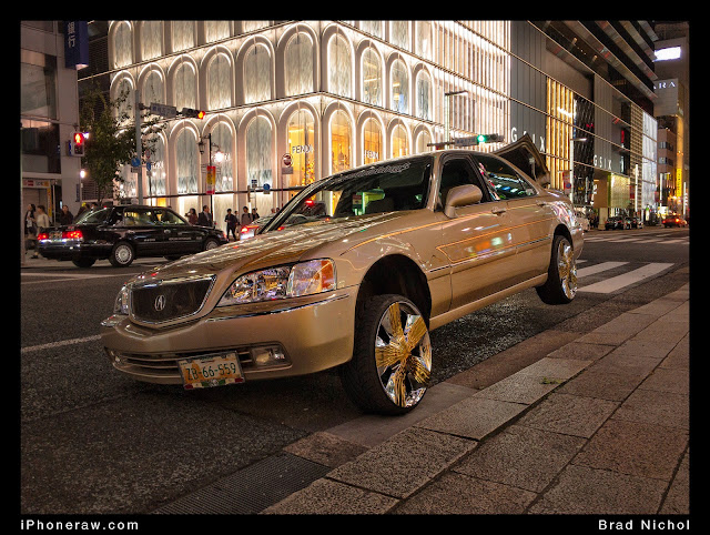 Modified Lexus LS430 in main street Ginza, with air bag suspension on three wheels.