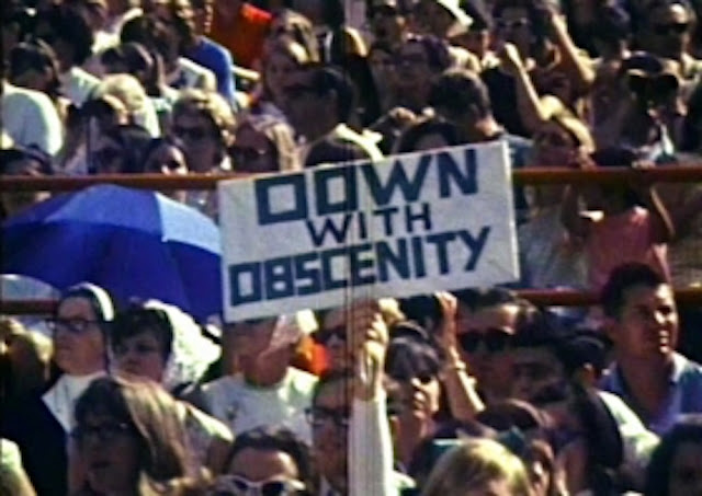 Down with Obscenity sign. Miami Rally for Decency, held in 1969 in reaction to Jim Morrison's lewd behavior and subsequent arrest.  Mr. Mojo Risin and other stories of Rock, Radio, and Regulations. Marchmatron.com