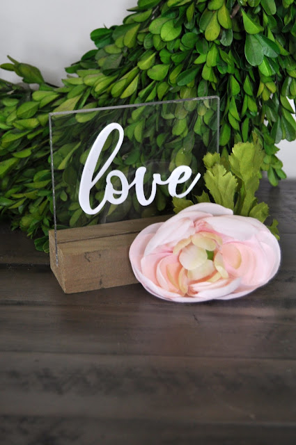 """Love"" acrylic stand designed by Jen Gallacher for Jillibean Soup. #weddingdecor #tablecenterpiece #acrylicsign"
