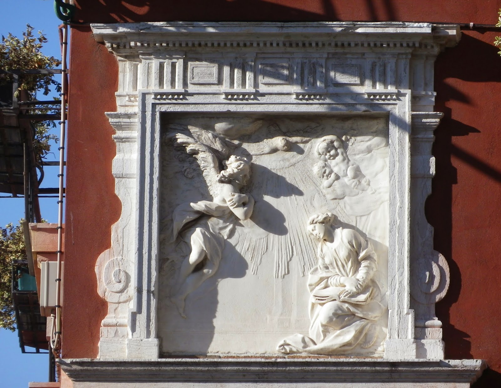Relief of the Annunciation by Giusto Le Court on the wall of a house overlooking the Ponte del Cavallo in Venice