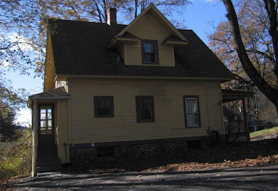 yellow house for sale at 70 Crescent Street, Winsted, CT