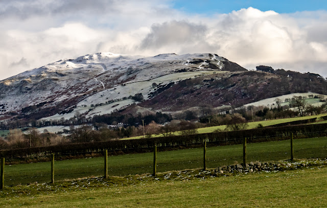 Photo of another view of snow on the hills