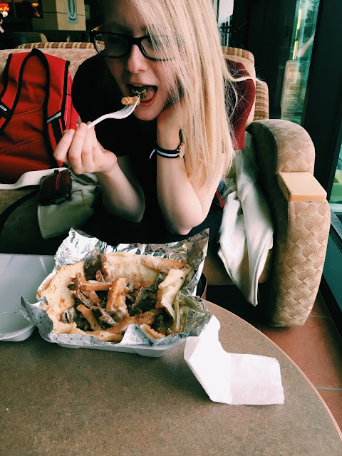 Rachel eats a Tombstone