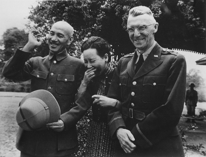 "Chiang's wife Song Meiling, and Gen. Joseph ""Vinegar Joe"" Stilwell in a light moment at Maymyo, Burma, 19 Apr 1942."