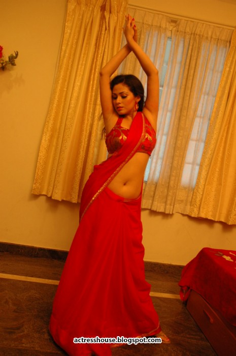 Sada deep navel show in red saree stills