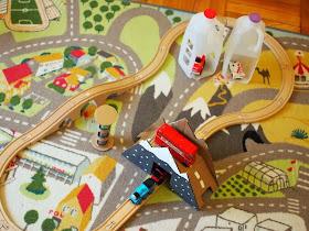 DIY toy cardboard bridge used during play