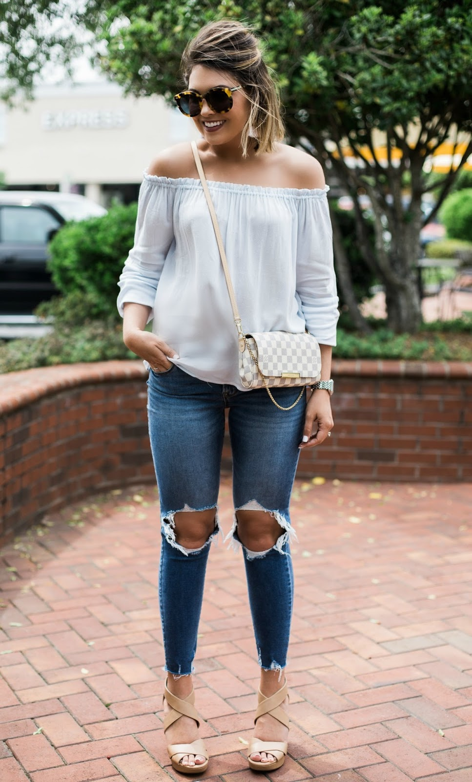 off the shoulder top, ripped denim, louis vuitton
