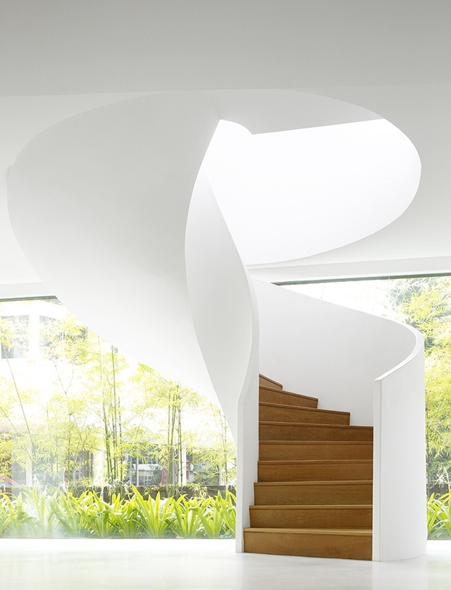 Spiral white concrete and wood stairs