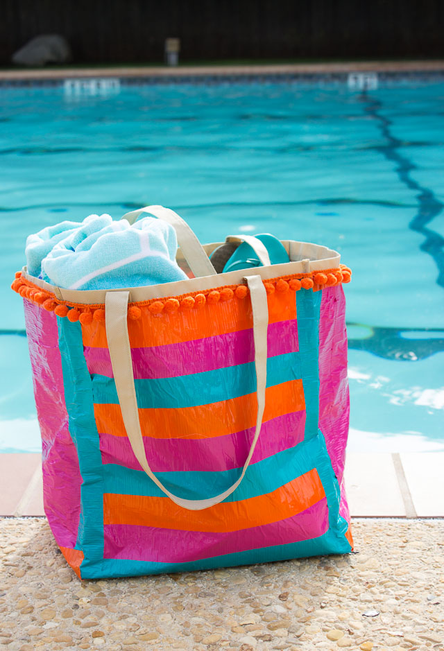 Transform an old shopping bag with duct tape to make the perfect pool bag!