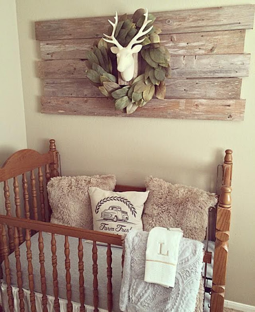 antler wall decor rustic baby nursery design