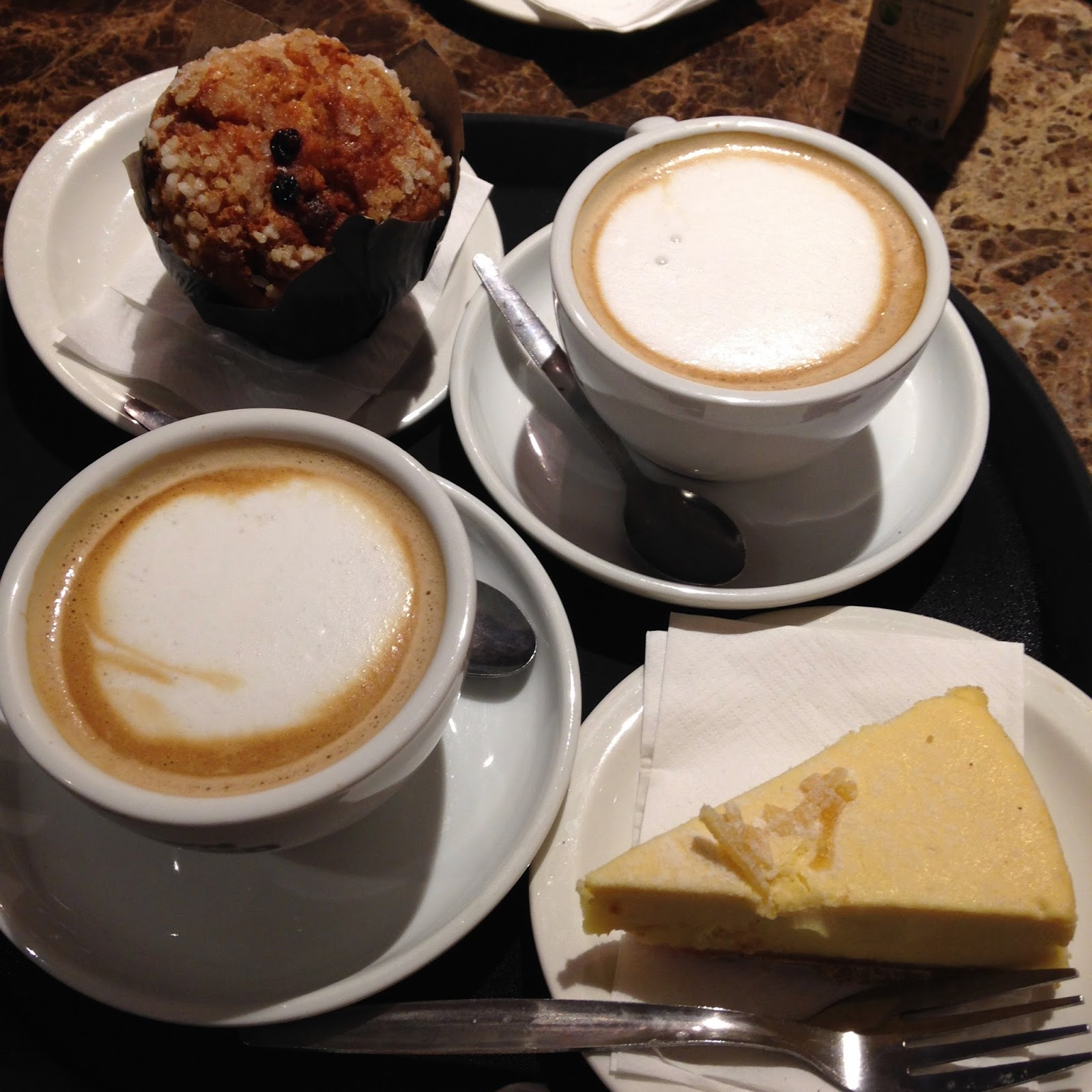 Two coffees and cakes on a tray