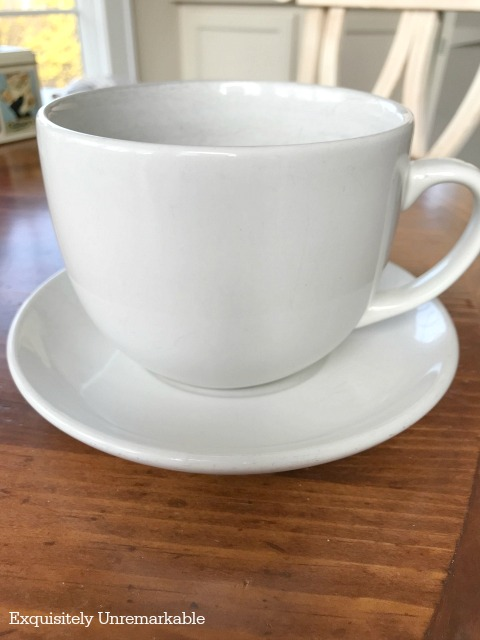 Large White Tea Cup and saucer on a table