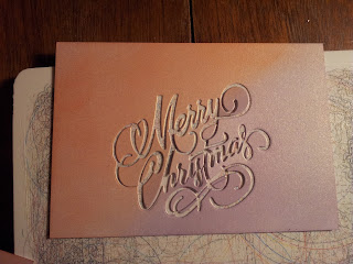 Purple and orange negative from die cut Merry Christmas sentiment