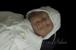 close up of ooak baby girl doll's sleeping face