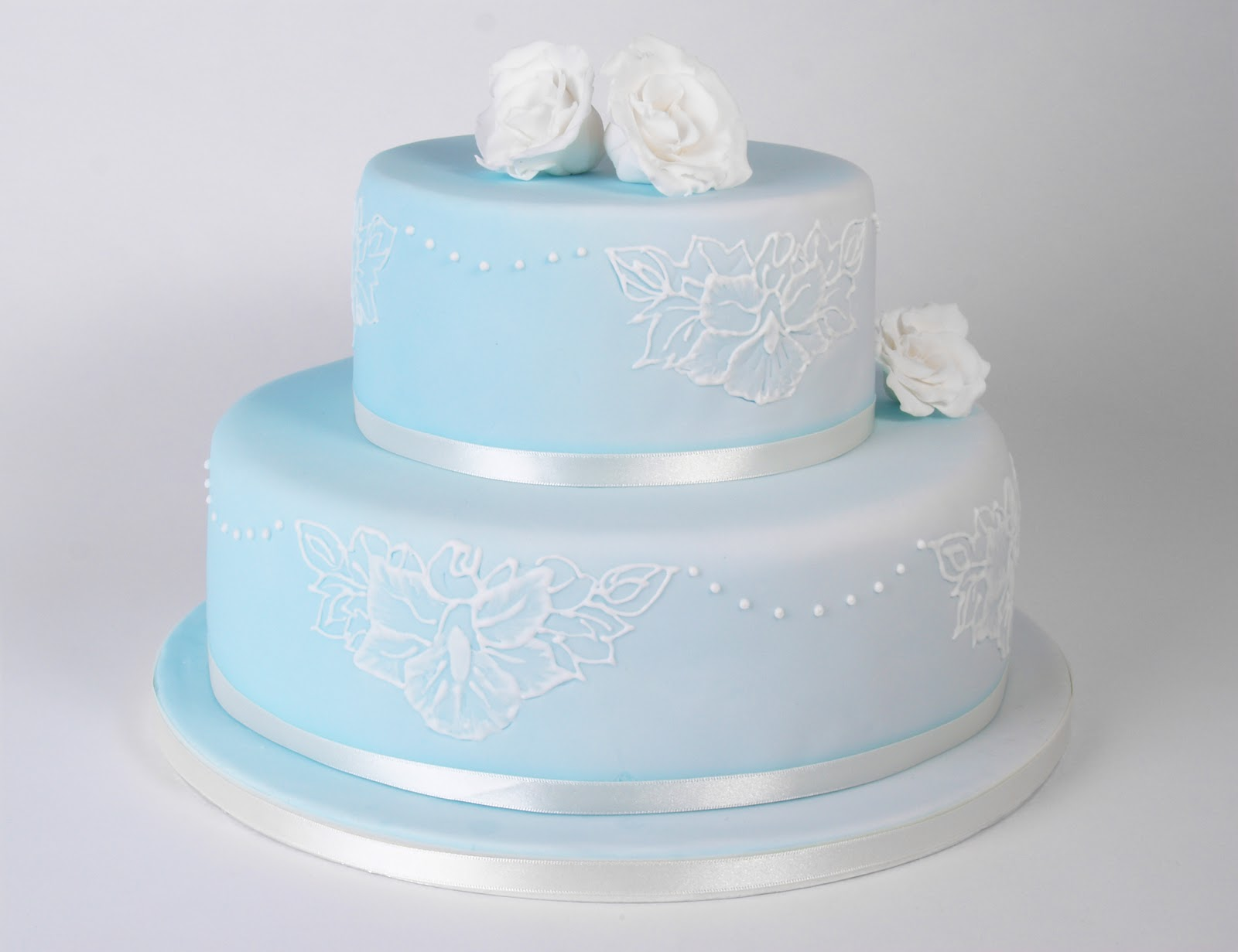 White Wedding Cake With Pink Ribbon