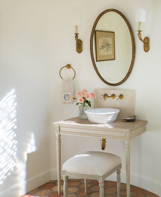 Gorgeous romantic French farmhouse style in a bathroom with Swedish antique vanity - found on Hello Lovely Studio