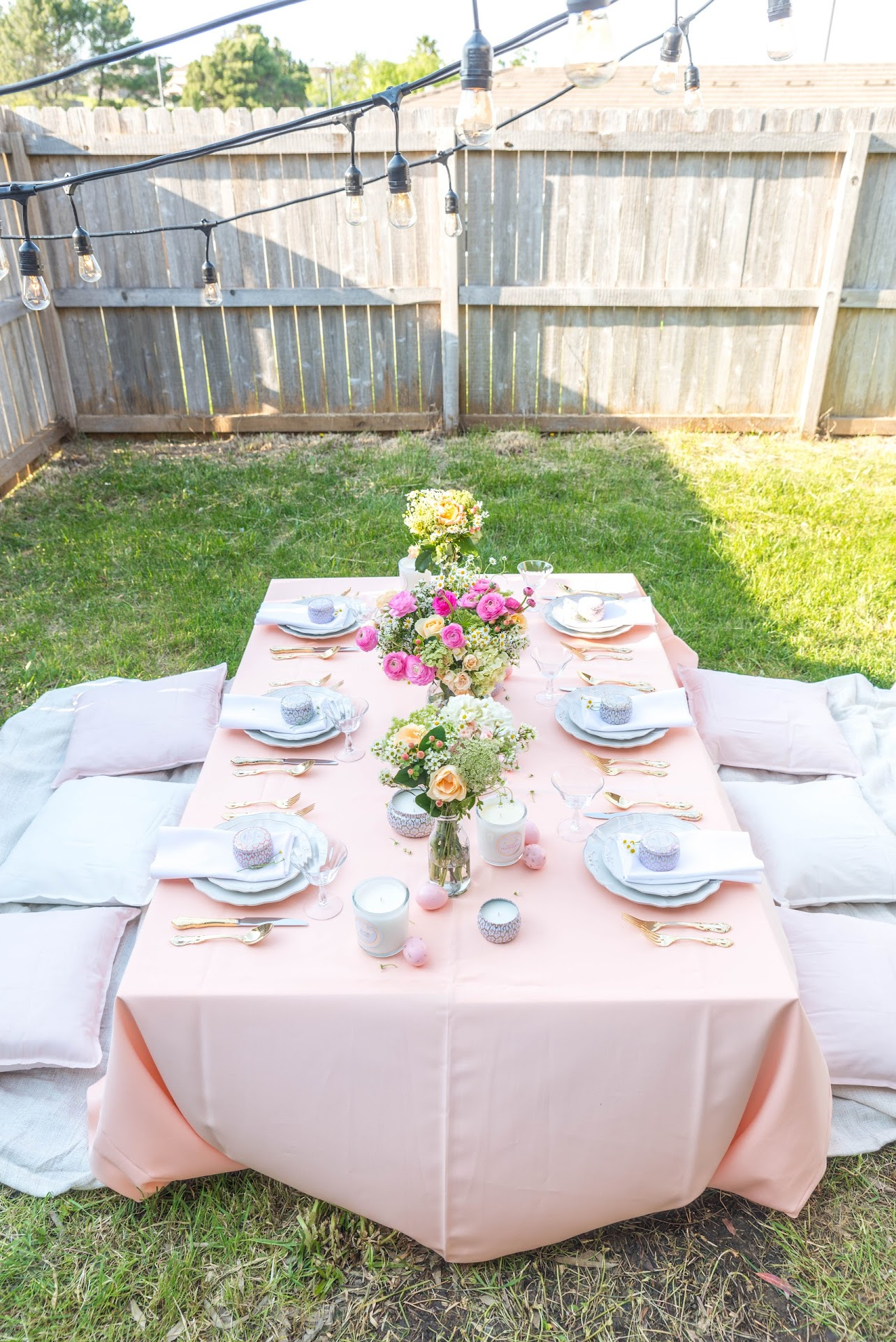 Easter dinner party, ideas, easter party, inspo, pink and peach color scheme, wedding, pink peach white, low diner table, low table party, backyard dinner party, party blogger, san francsico bay area blog, california, backyard picnic, unique party ideas, tablescape, gold flatware, Classic Party Rentals, Voluspa Candles,