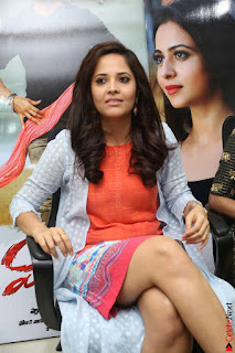 Actress Anasuya Bharadwaj in Orange Short Dress Glam Pics at Winner Movie Press Meet February 2017 (24).JPG
