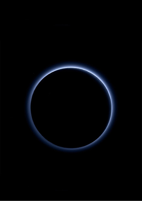 Pluto's hydrocarbon haze keeps dwarf planet colder than expected