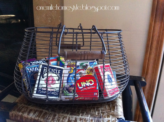 Wire basket to organize card games.
