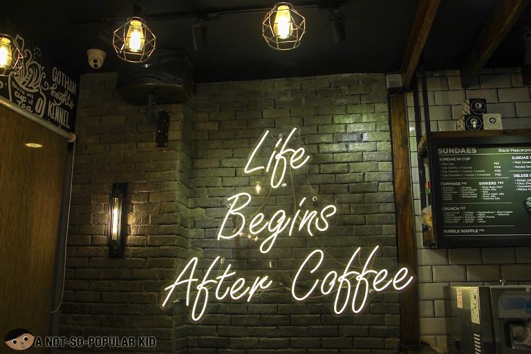 Life Begins After Coffee Signage in Black Scoop Cafe