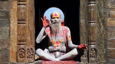 Picture of a painted man meditating