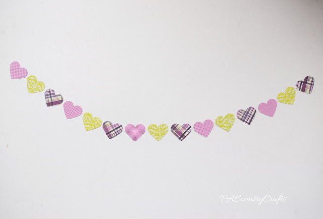 Paper punched hearts sewn together to make a fun Valentine garland!