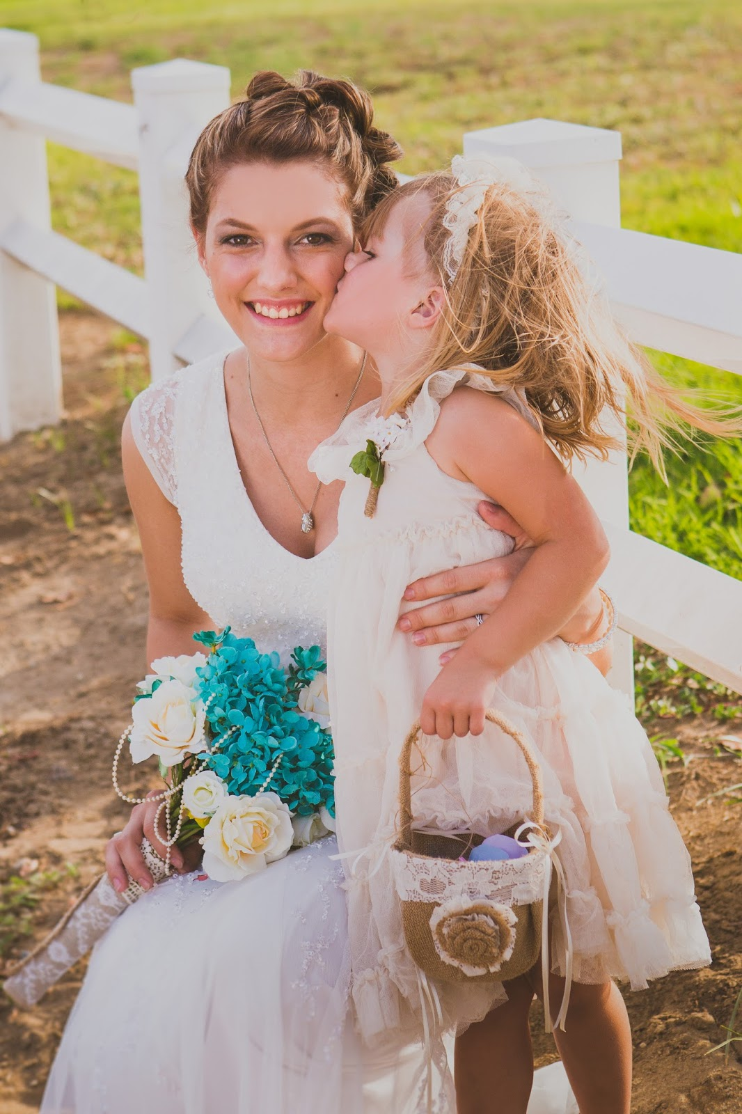 flower girl kisses the bride on the cheek