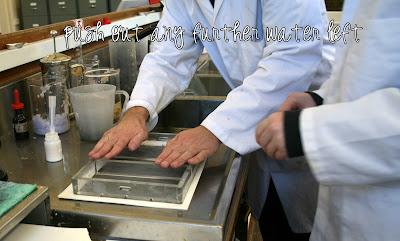 Paper making - Pushing water from frame