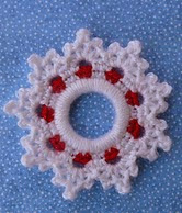 http://www.ravelry.com/patterns/library/peppermint-snowflake-ring-ornament
