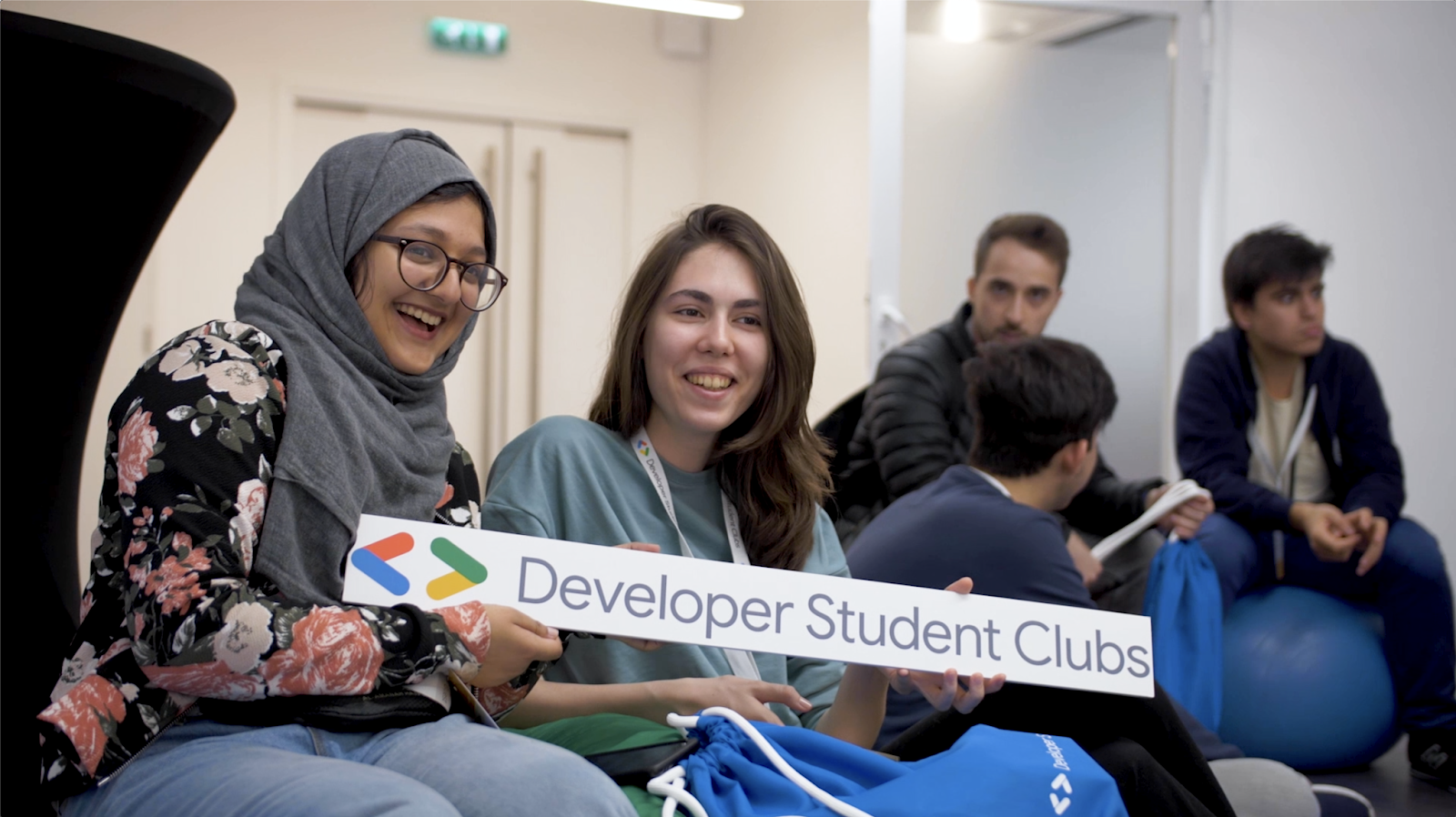 Image description: People holding up Developer Students Club sign