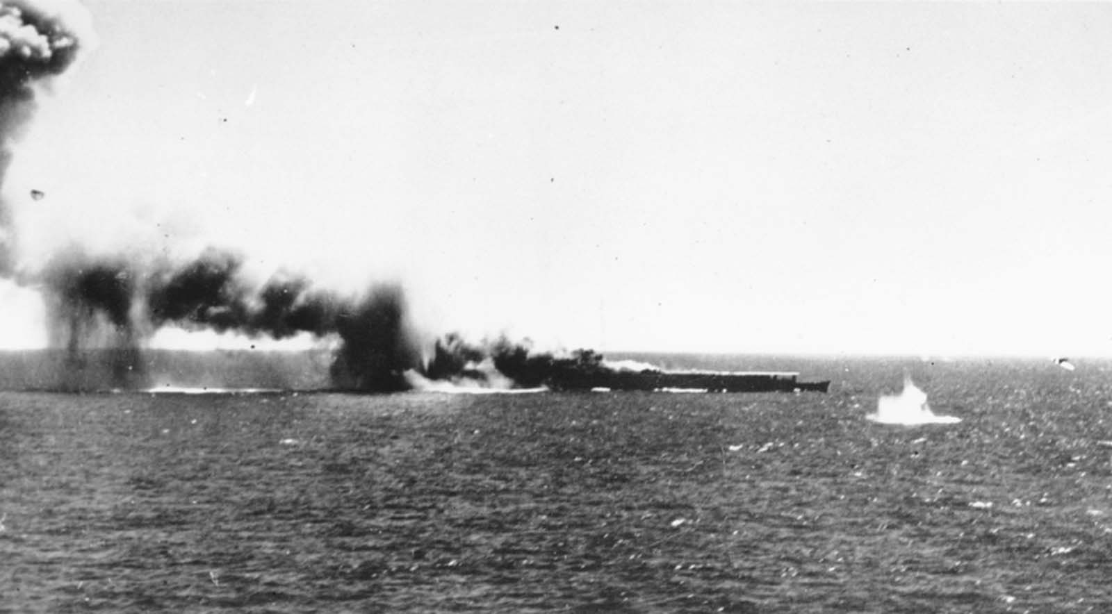 A Japanese aircraft carrier is bombed by a U.S. Navy plane in the Battle of the Coral Sea, in May of 1942. This was the first naval battle in history in which neither side's ships ever sighted or fired directly upon the other.