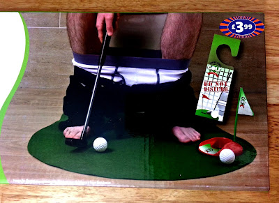 Toilet Golf Set box, featuring man on toilet putting a golf ball.