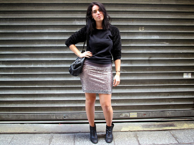 Fashion blogger Emma Louise Layla in Paris wearing black fluffy jumper and silver sequin skirt