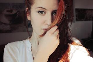 redhead hiding her face with hair.jpeg