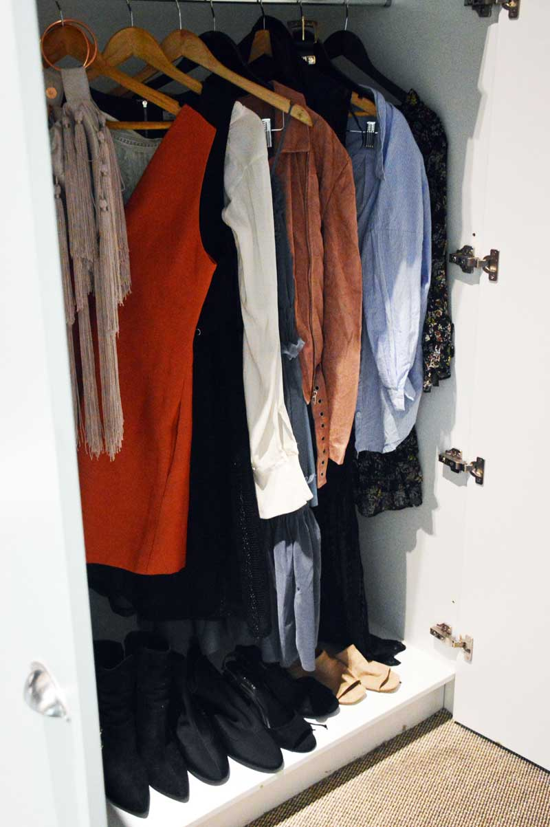 beautiful clothes for fashion week hanging in wardrobe