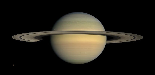 Saturn as seen by NASA's Cassini spacecraft in 2008. Long-term tracking of the spacecraft's position has revealed no unexplained perturbations in Cassini's orbit. Credit: NASA/JPL/Space Science Institute