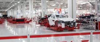 Tesla assembly line (Credit: Tesla) Click to Enlarge.