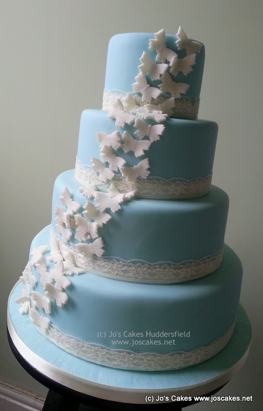 Four Tier Pale Blue Wedding Cake With Erflies And Lace