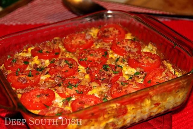 A garden fresh casserole featuring sweet summer corn and tomatoes, onion, sweet bell pepper and garden fresh herbs.