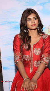 Actress Heba Patel Latest Stills in Red Dress at Mister Movie Trailer Launch Event  0013.jpg