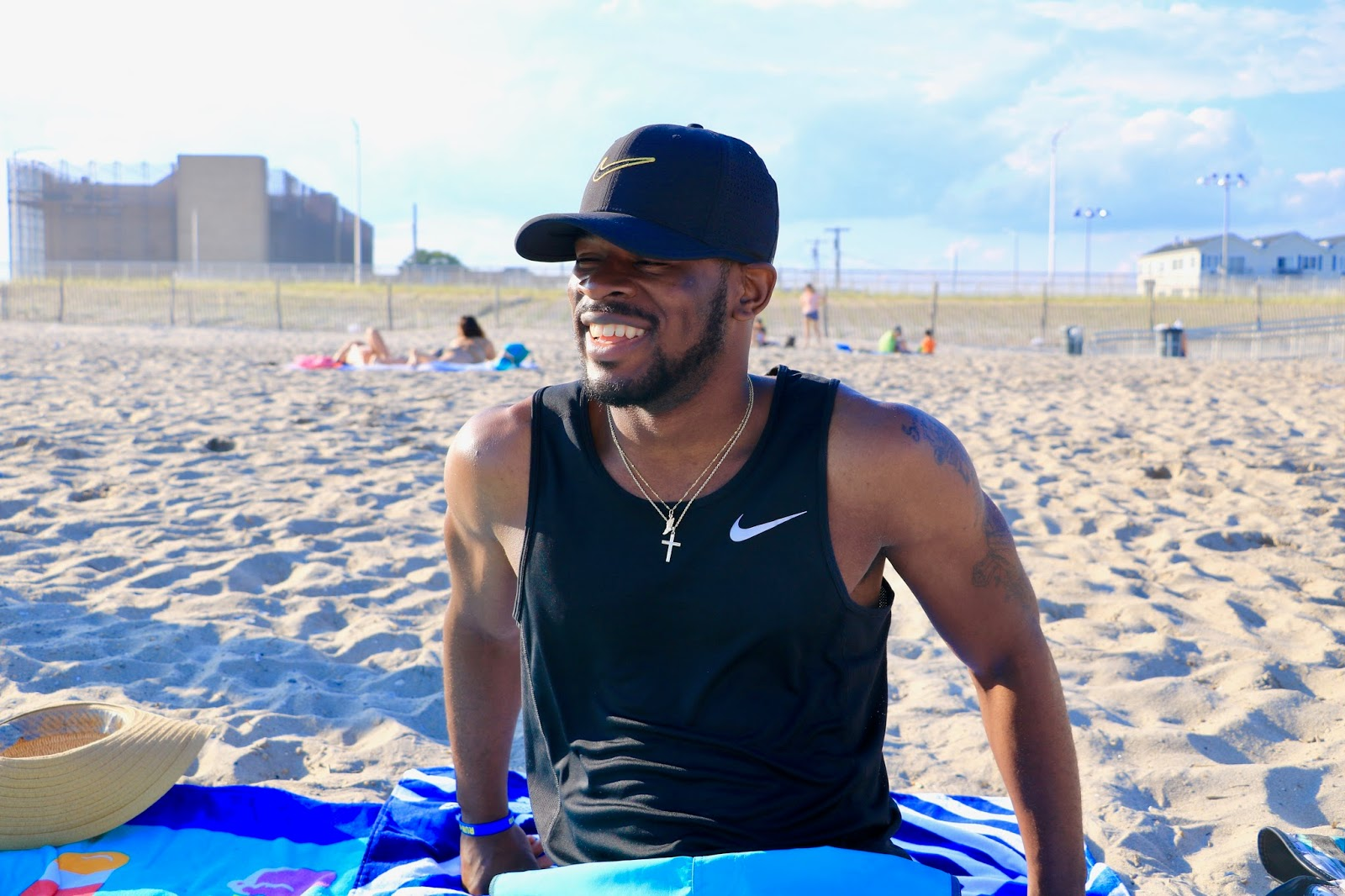 Antonio Owens in Nike athletic wear on the beach