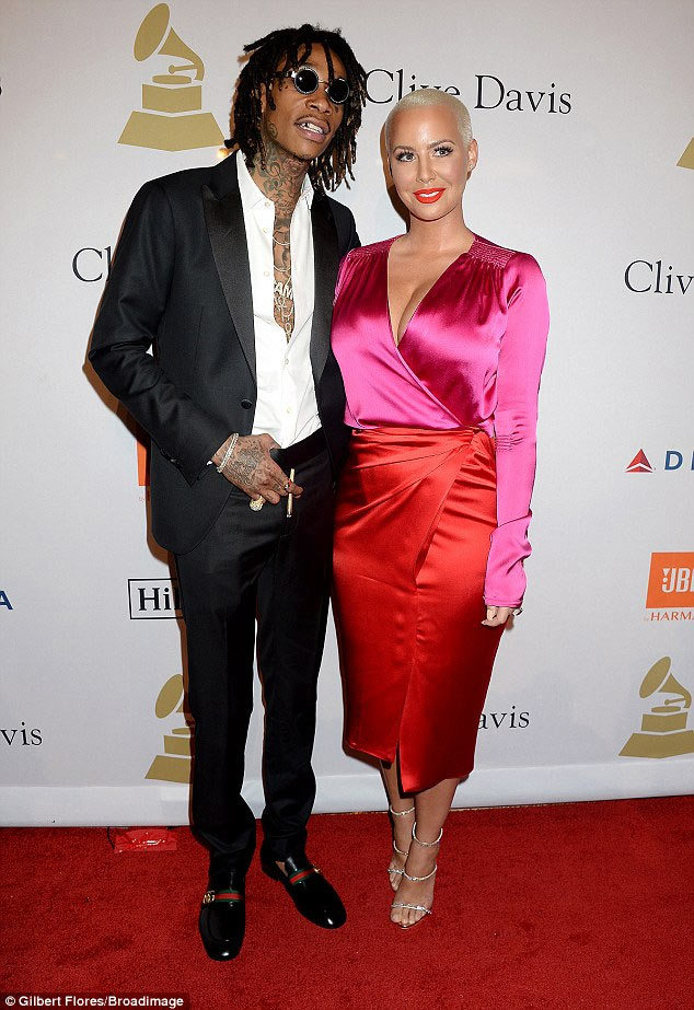 Wiz Khalifa and Amber Rose are definitely back together as divorced couple canoodle at Grammy event