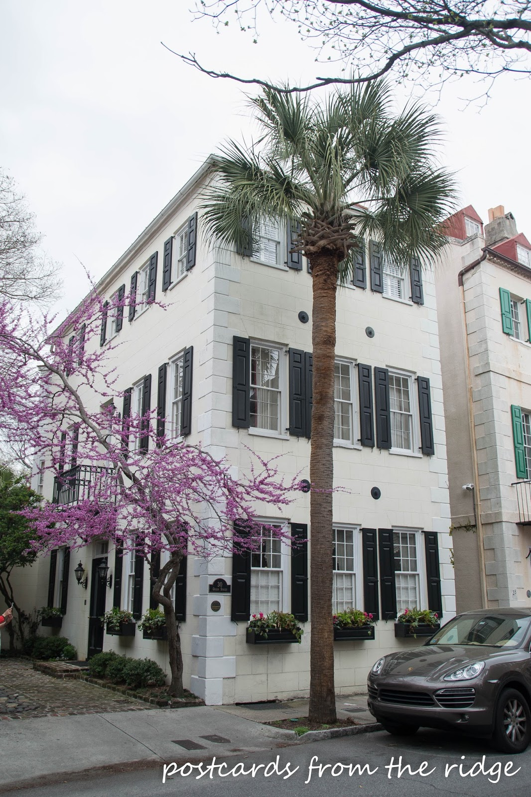 Pretty old home in the French quarter of Charleston, SC. Love the redbud tree! Postcards from the Ridge.