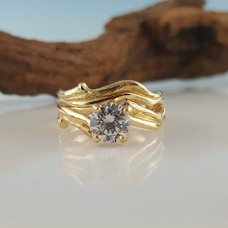 Twig Bridal set with a 1 carat Charles and Colvard Moissanite in 14, 18, Gold Bridal Set that is all handsculpted. A nice alternative wedding set that has a nice organic look.