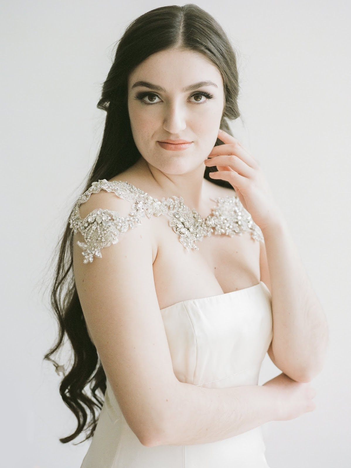 Win this beaded crystal bolero by She Wore Flowers designer, Abigail Grace Bridal! This wedding accessory is beautifully handmade and is one of many bridal accessories available from She Wore Flowers.